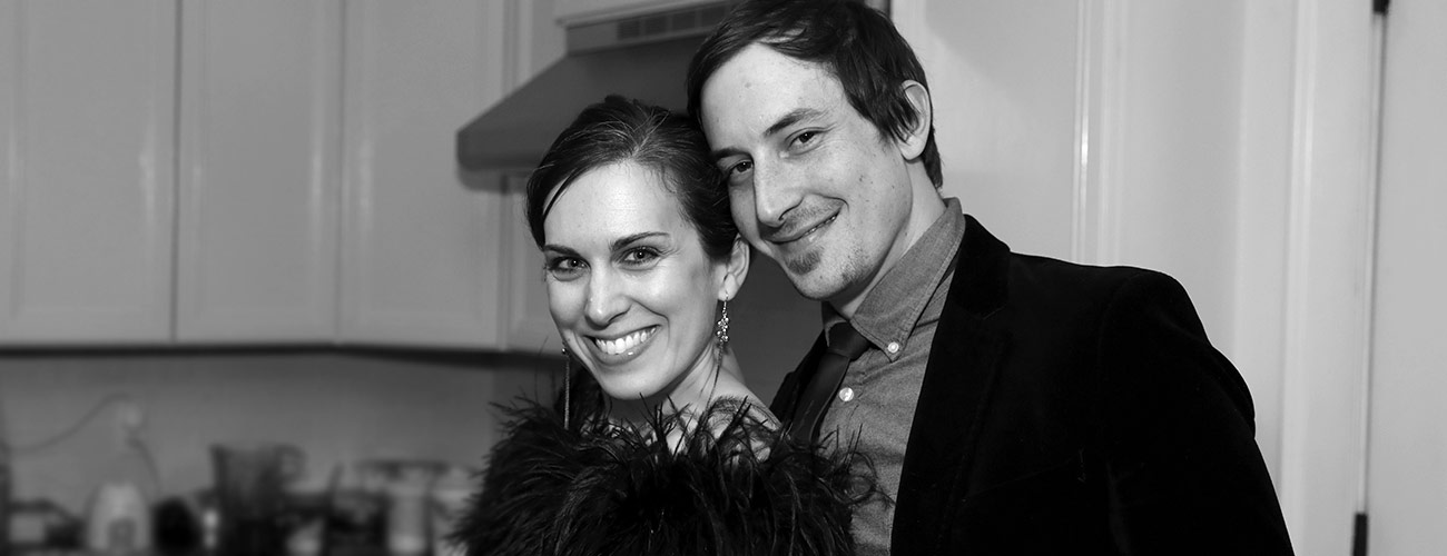 Ashley Lopez, designer-turned-content strategist at Julia Balfour, poses with her husband at the office Christmas Party.